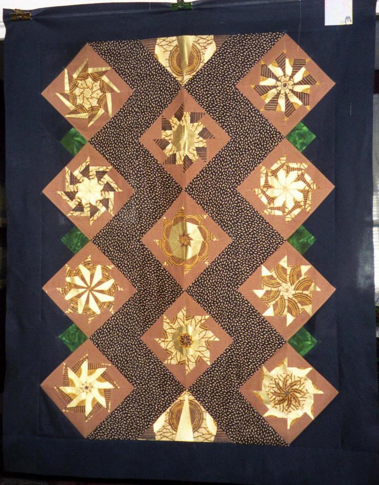 T-Golden Pinwheels | The metallic in this focus fabric is ve