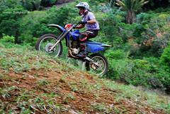 trail(0.0), mountain bike(0.0), mountain bike racing(0.0), cycle sport(0.0), downhill(0.0), mountain biking(0.0), bicycle(0.0), racing(1.0), soil(1.0), enduro(1.0), vehicle(1.0), sports(1.0), freeride(1.0), sports equipment(1.0), downhill mountain biking(1.0), motorsport(1.0), motorcycle racing(1.0), extreme sport(1.0),