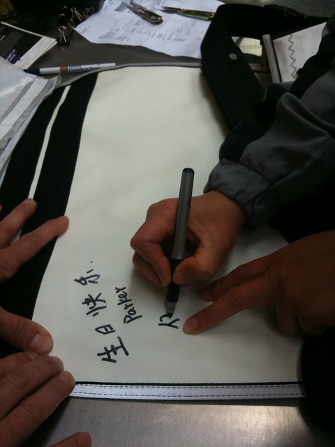 Hui signing the sail bag