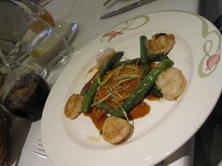 Caramelized Sea Scallops With Roasted Asparagus, Sun-dried Tomatoes, and Pearl Pasta, garnished with Caramelized Leeks and Veal Jus Reduction