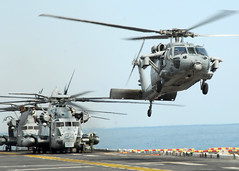 PACIFIC OCEAN (March 22, 2011) An MH-60S Sea Hawk helicopter lands on the flight deck of the forward-deployed amphibious assault ship USS Essex (LHD 2). (U.S. Navy photo by Mass Communication Specialist 2nd Class Eva-Marie Ramsaran)