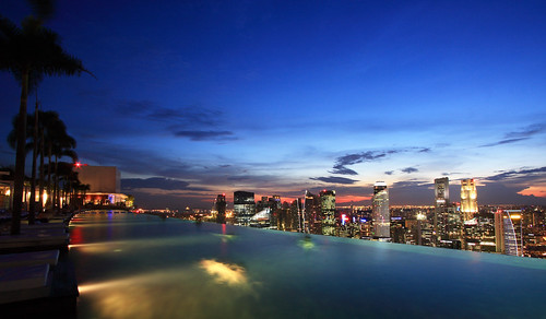 park blue trees light sky pool skyline night marina swimming swim buildings evening bay twilight singapore asia view dusk palm oasis hour sin swimmer southeast sands mbs
