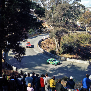 Holden HK Monaro GTS trails a Buckle Mini Monaco down through Craven A Corner at Catalina Park Circuit, Katoomba