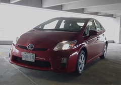 automobile(1.0), toyota(1.0), wheel(1.0), vehicle(1.0), bumper(1.0), toyota prius(1.0), land vehicle(1.0), hatchback(1.0),