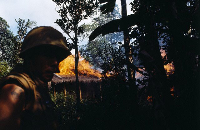US and South Vietnamese troops set fire to a shack under