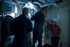 PACIFIC OCEAN (March 24, 2011) - Electrician's Mate Fireman Jeremy Jordan from Dunganon, Va. works with Puget Sound Naval Shipyard electricians Bill Murray (left) and John Stafford (right) to perform maintenance on an electrical distribution panel for the laundry facilities aboard the aircraft carrier USS George Washington (CVN 73). (U.S. Navy photo by Mass Communication Specialist 3rd Class Juan M. Pinalez Jr./RELEASED)