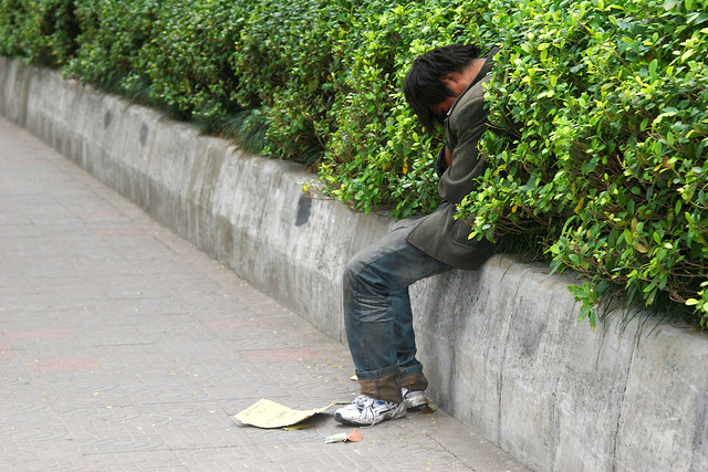 A homeless man in Guangzhou, China.