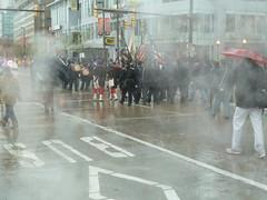 violence(0.0), riot(0.0), rain(1.0), street(1.0), pedestrian(1.0),