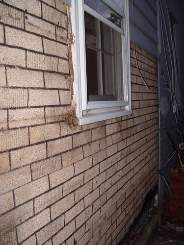 The siding project marches on old town home for Brick veneer siding problems
