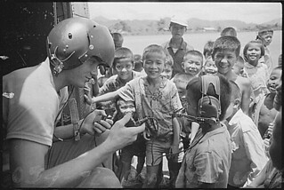 Para-rescue technician talks to Thai children who were attracted by the helicopter's landing., 06/05/1972