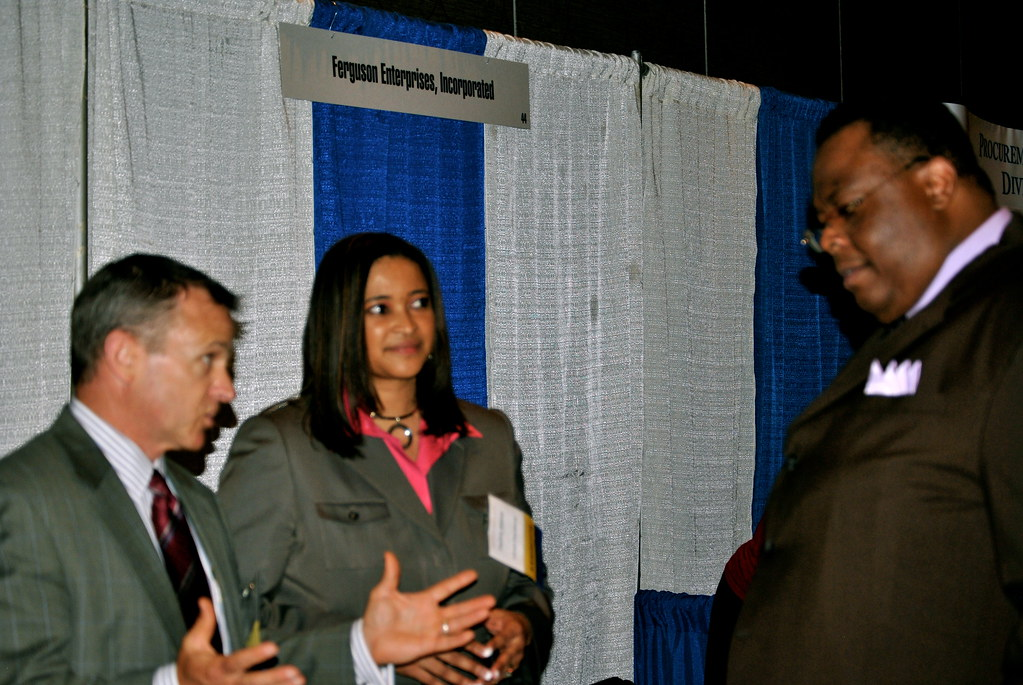 Team ACP CEO Sylvester Clay networking with Exhibitors   Flickr