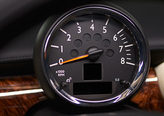 wheel(0.0), rim(0.0), steering wheel(0.0), luxury vehicle(0.0), automobile(1.0), vehicle(1.0), gauge(1.0), speedometer(1.0), land vehicle(1.0), tachometer(1.0),