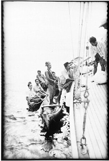 Loading bags from canoes onto SIRIUS, Buton, Indonesia