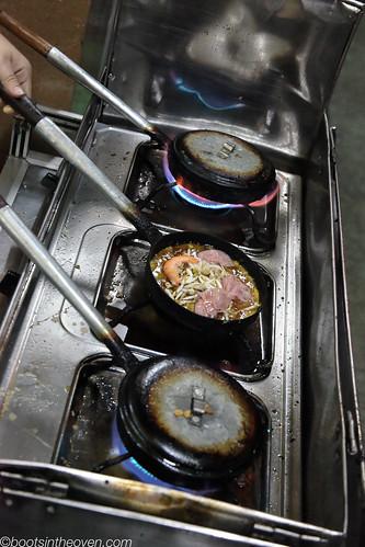 Bánh khoái cooking at Lạc Thiện