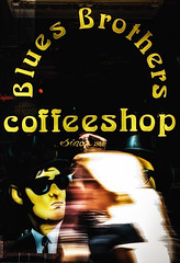 Blond girl passes Blues Brother coffeeshop (Amsterdam)
