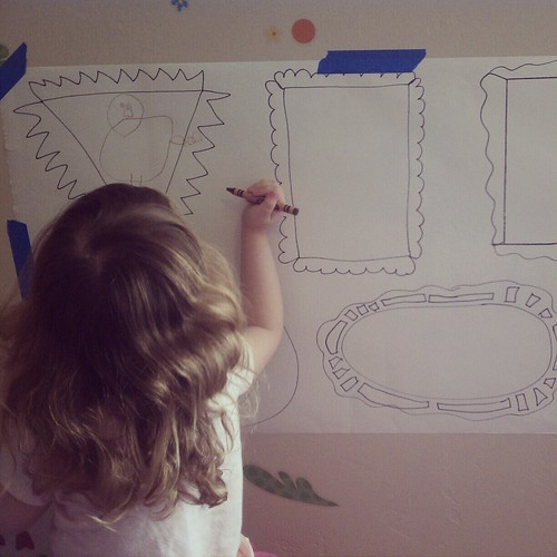 Lily drawing in her frames