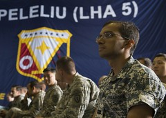 Republic of Singapore Navy Lt. Bimal Vora watches a presentation during the inaugural RIMPAC Military Medicine Symposium aboard USS Peleliu (LHA 5). (U.S. Navy/MC3 Pyoung K. Yi)