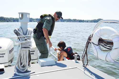 Officer assists a boater who fell from a speeding jet ski on the Severn River