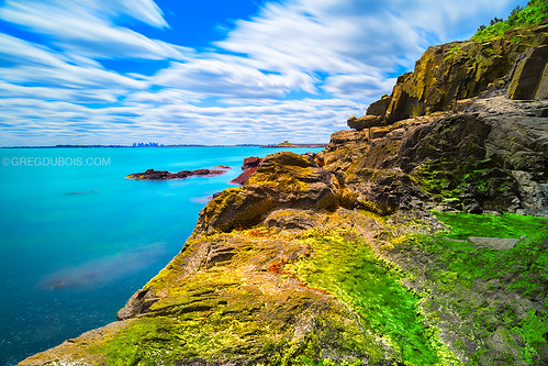 longexposure blue sea cliff usa sunlight motion green nature water yellow clouds canon landscape photography harbor seaside movement rocks colorful aqua warm day unitedstates cloudy vibrant teal horizon shoreline newengland rocky surreal bluesky rockface seacliff filter shore nd aquatic dramaticsky tidepools atlanticocean waterway cloudysky eastcoast nahant bostonskyline greenwater vibrantcolor oceancliff cloudmovement nahantma neutraldensity extremeexposure bostonphotographer littlenahant broadsound bostonphotography nahantmassachusetts baileyshillpark gregdubois northshoreboston lewiscove