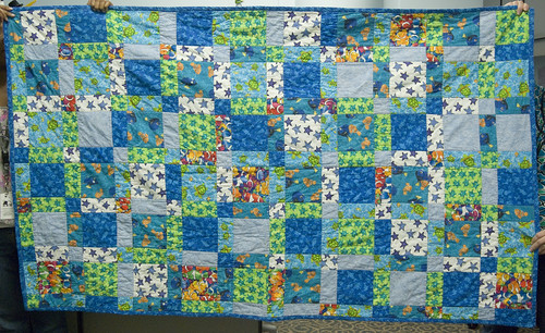 Beth was kind enough to bring in the quilt, almost two years after it was finished, for an 'after' photo and a sewn-in quilt label. Done and done!  I don't think I will do many more disappearing 4-patch quilts. They're lovely and quick, but I feel like there's nothing left to learn where this pattern is concerned.