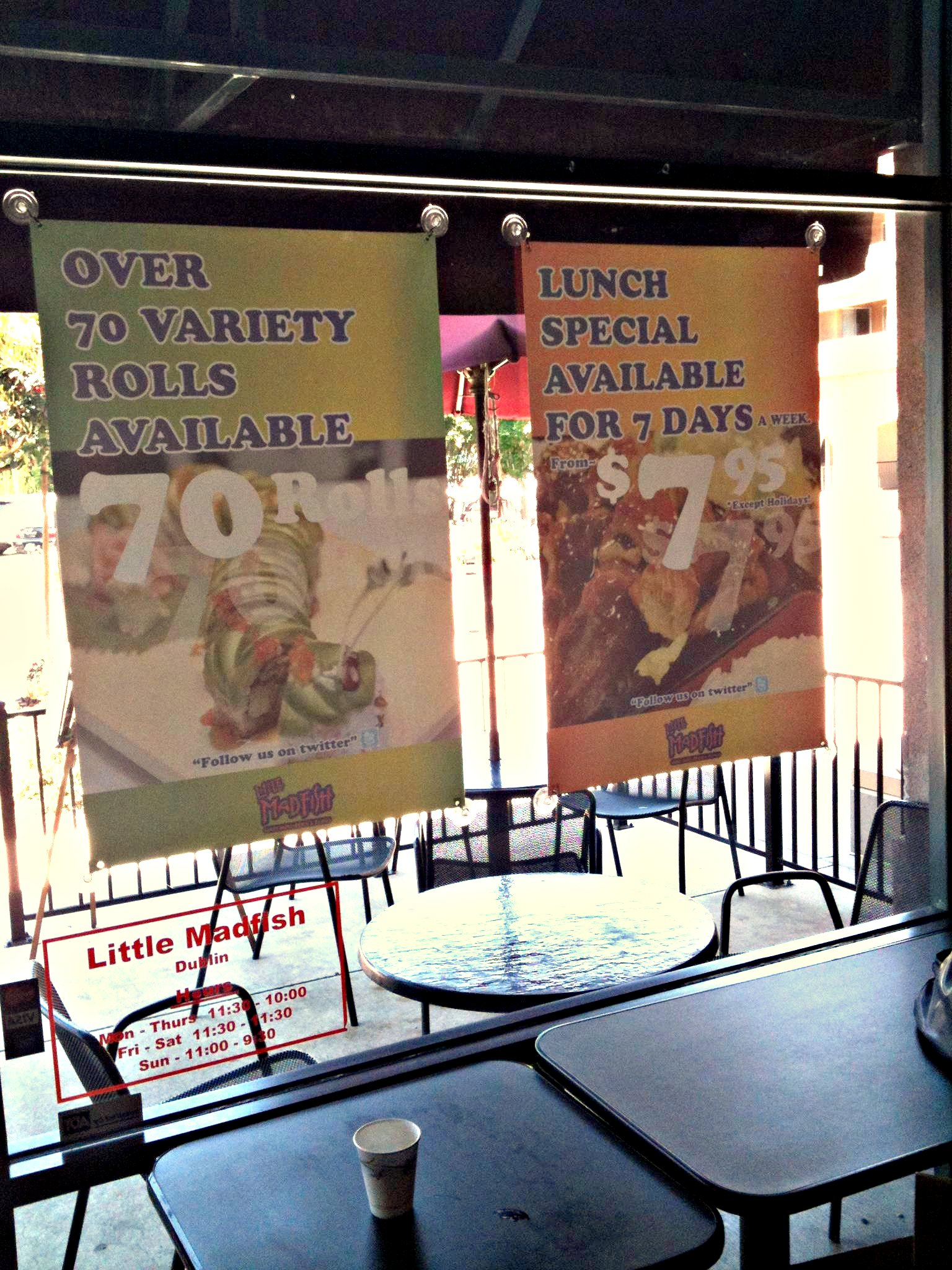 Little madfish restaurant window ads turned backwards for Mad fish restaurant