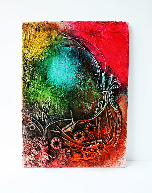 Mixed-media-canvas-with-old-lighting-parts