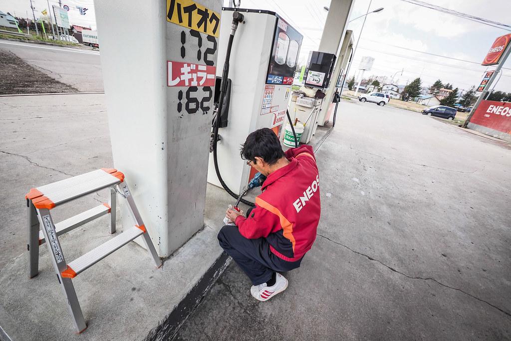 Filling the MSR Whisperlite Internationalle stove bottle at a petrol station in Kawabata, Hokkaido, Japan
