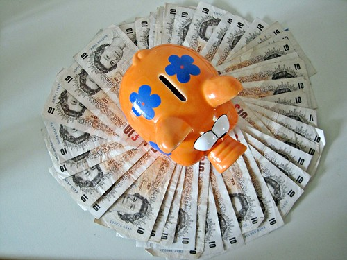 Piggy bank on fan of UK Pounds