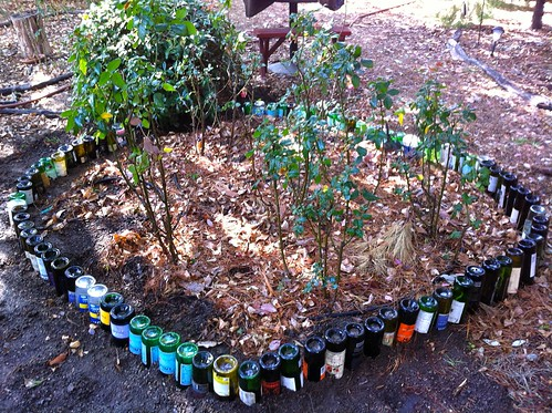 Wine bottle garden bed edging done