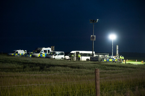 cops in a field at night by mdx