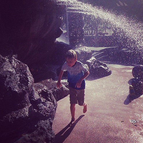 Playing in a public fountain. They're having a great time. Palm Springs vacation.