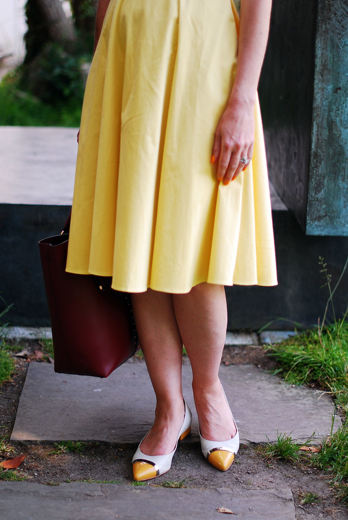 Vintage-style yellow dress and pointed flats