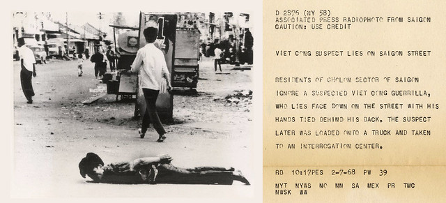 VIETNAM WAR PHOTO - VIET CONG SUSPECT LIES IN SAIGON STREET