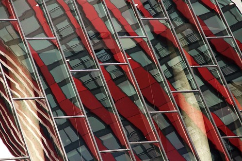 "Reflection of the ""Red Apple"" building"