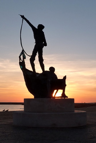 Quarteira sculpture at sunset
