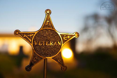 old cemetery grave metal sunrise star spring shiny flickr bokeh military sunny veteran brass burialground facebook clearskies morming