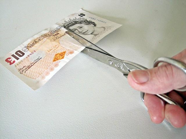 £10 note being Cut in Half