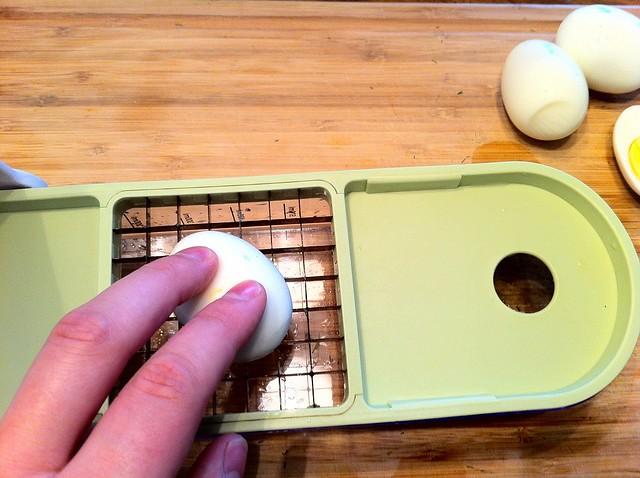Pressing Hard Boiled Egg Thru Dicer