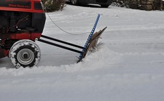 winter(1.0), vehicle(1.0), tool(1.0), snow(1.0), snow removal(1.0), snowplow(1.0), snow blower(1.0), blizzard(1.0),