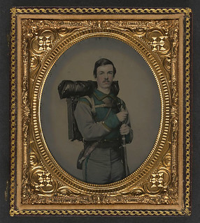 "[Unidentified soldier in Confederate uniform of Co. E, ""Lynchburg Rifles,"" 11th Virginia Infantry Volunteers holding 1841 ""Mississippi"" rifle, Sheffield-type Bowie knife, canteen, box knapsack, blanket roll, and cartridge box] (LOC)"