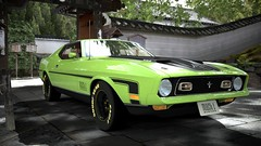 race car(1.0), automobile(1.0), automotive exterior(1.0), vehicle(1.0), ford mustang mach 1(1.0), ford(1.0), antique car(1.0), land vehicle(1.0), muscle car(1.0), sports car(1.0),