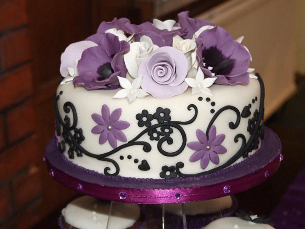 Ivory purple black wedding cake Fruity malibu madeira cake covered in a