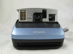 projector(0.0), cameras & optics(1.0), camera(1.0), electronic device(1.0), multimedia(1.0), instant camera(1.0), camera lens(1.0),
