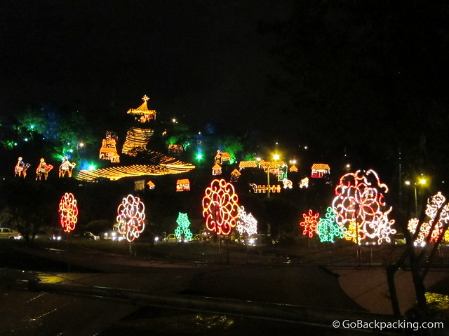 The December 2010 Christmas light display on Cerro Nutibarra as seen from the Medellin River