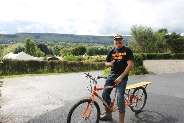 Matt on his bike at the national permaculture convergence 2016, with Ilkley moor in the background