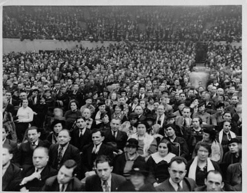 """A large crowd gathers [at Madison Square Garden?] during the 1933 New York Dressmakers Strike.  A sign in the background reads: """"...Makers Union ILGWU."""""""