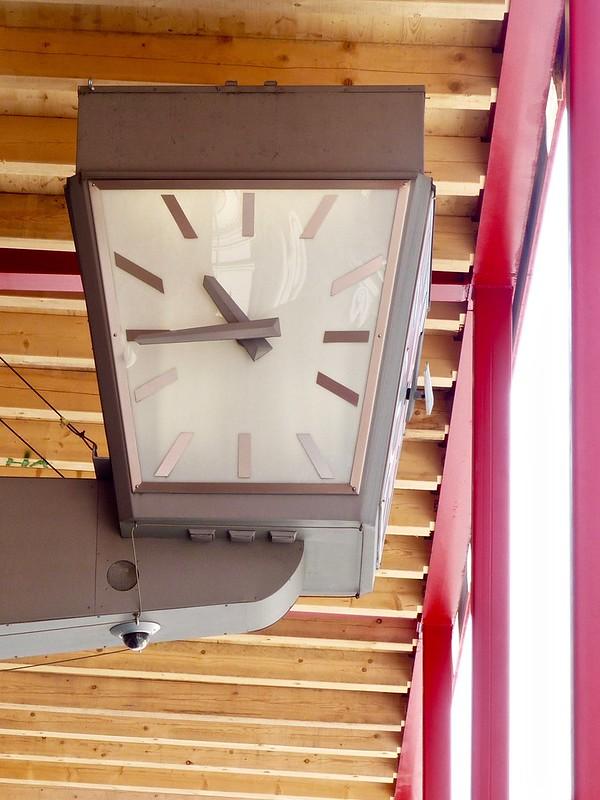 Clock Sign of Master Watchmaker Hübner under a scaffold, in Vienna Austria