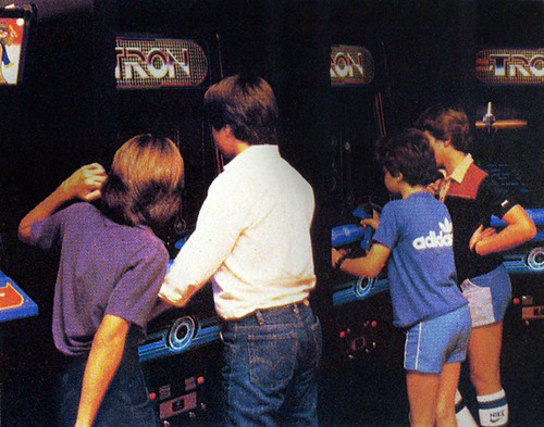 Kids Playing Tron At Arcade