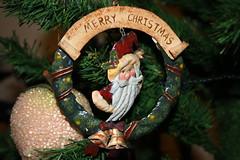 nativity scene(0.0), decor(1.0), branch(1.0), tree(1.0), christmas decoration(1.0), christmas(1.0), wreath(1.0),