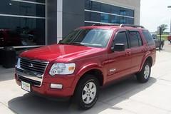 ford escape hybrid(0.0), automobile(1.0), automotive exterior(1.0), sport utility vehicle(1.0), vehicle(1.0), compact sport utility vehicle(1.0), rim(1.0), ford explorer(1.0), bumper(1.0), ford(1.0), land vehicle(1.0), luxury vehicle(1.0),